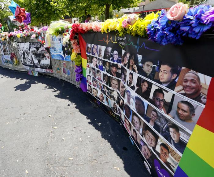 A display with the photos and names of the 49 victims that died at the Pulse nightclub memorial.