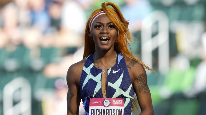Sha'Carri Richardson celebrates after winning the first heat of the semis finals in women's 100-meter runat the U.S. Olympic Track and Field Trials in Eugene, Ore.