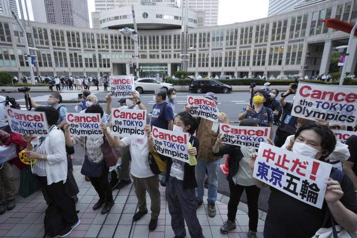 People protest against the July opening of the Tokyo 2020 Olympics near the Tokyo Metropolitan Government building in Tokyo.