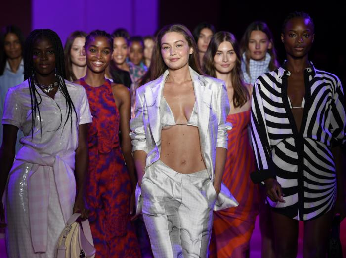 Models, including Gigi Hadid, center, walk the runway during the finale at the Brandon Maxwell spring/summer 2022 fashion show in the Brooklyn borough of New York during Fashion Week on Friday, Sept. 10, 2021